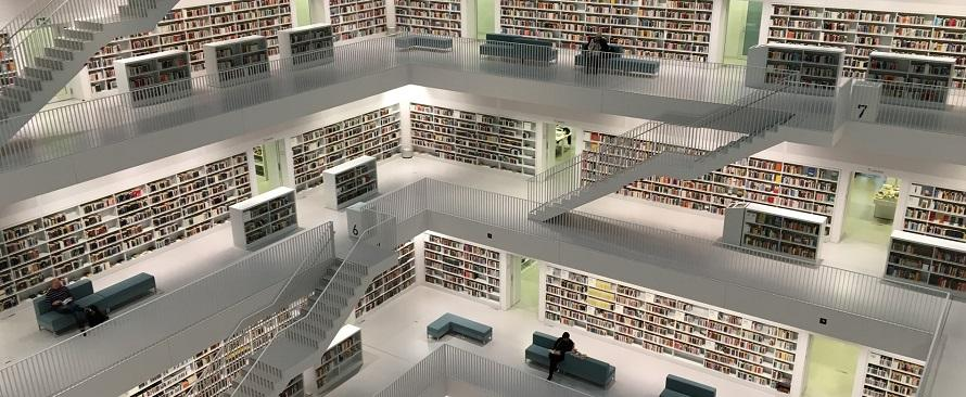 Photo of several floors of a light-filled library with stair cases